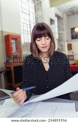 Close up Office Woman Sitting at her Worktable Busy Reviewing the Business Documents - stock photo