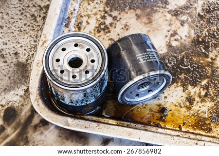 Close up old and dirty car oil filter, automotive maintenance service - stock photo