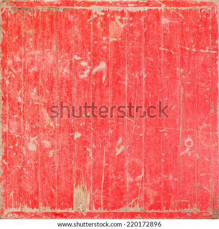 Close up old and weathered red color wooden wall texture
