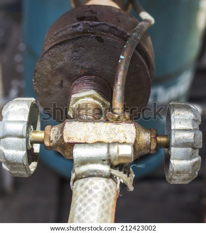 close up old gas stove valve - stock photo