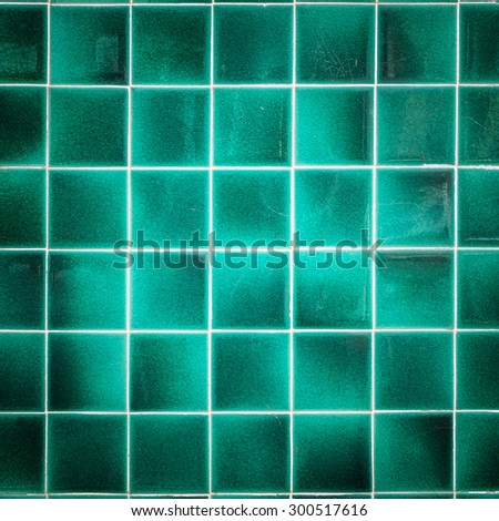 close up old pattern green ceramic bathroom wall tile texture and background