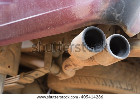 close up old pipe car exhaust rusty - stock photo