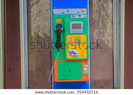 close up old public telephone coin in Thailand - stock photo
