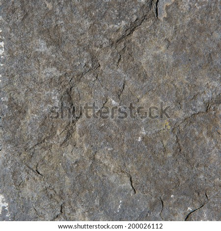 Close up old weathered gray rock textured background - stock photo