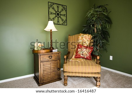 Close up on a corner of a house with a chair and nightstand