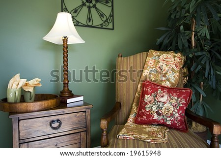 Close up on a corner of a house with a chair and nightstand - stock photo