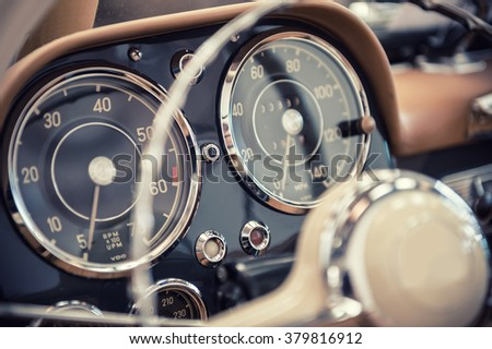 Close up on a dashboard of a vintage car - stock photo