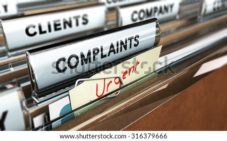 Close up on a file tab with the word complaints, focus on the main text and blur effect. Concept image for illustration of Customer Service complaint management - stock photo
