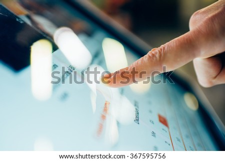 Close up on a finger touching the screen of a tablet - technology, social network, communication concept - stock photo