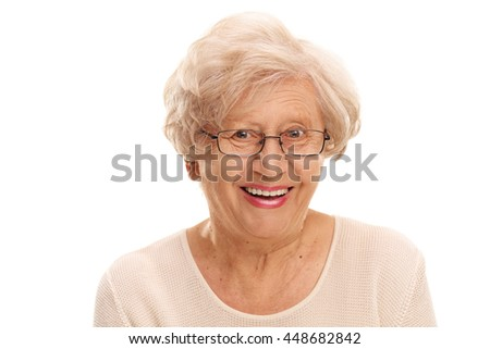 Close-up on a joyful senior lady smiling and looking at the camera isolated on white background - stock photo