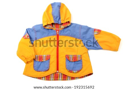 Close up on a newborn baby jacket, baby small colored coat - stock photo