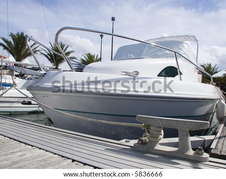 Close-up on a speed boat on harbor - stock photo