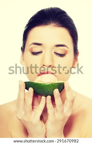 Close up on a woman eating avocado - stock photo