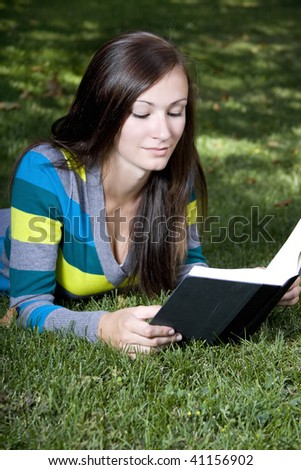 Close up on a Woman's Face Reading a Book - stock photo