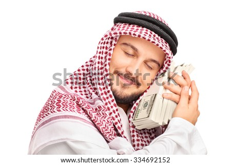 Close-up on a young male Arab person sleeping on money and smiling isolated on white background - stock photo