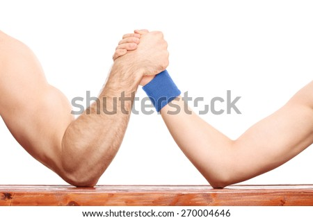 Close-up on an uneven arm wrestling contest between a muscular arm and a skinny one isolated on white background - stock photo