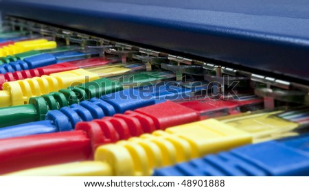 Close-up on brightly colored computer  network plugs connected to a router / switch