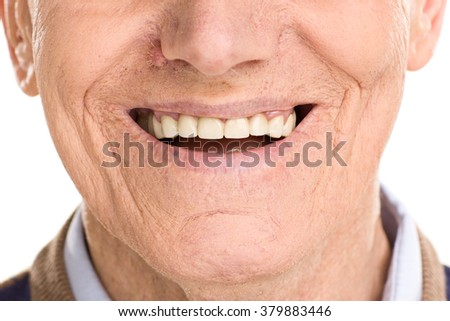 Close-up on cheerful senior man smiling isolated on white background - stock photo