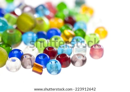 Close up on colorful translucent beads isolated on white background