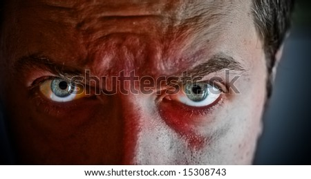 Close-up on criminal with blood on his face - stock photo