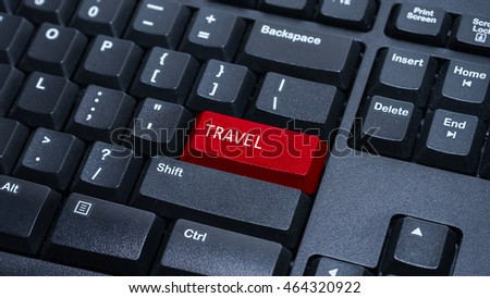 Close up on customized computer enter button on keyboard with a word travel.