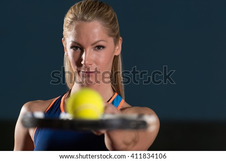 Close-up On Female Tennis Player Holding Racket With Ball - stock photo