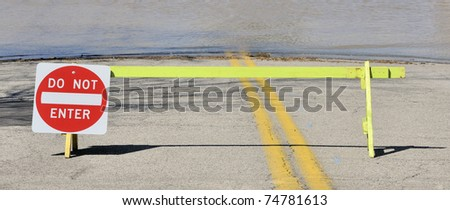 Close-up on flooded road and do not enter sign. Ohio River, USA - stock photo