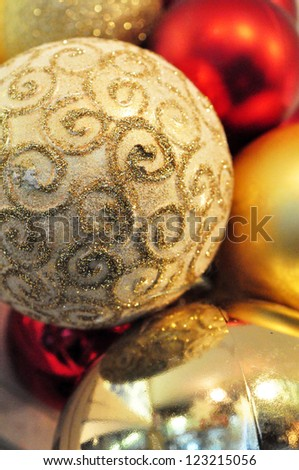 Close up on gold and red christmas baubles