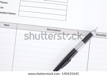 Close-up on invoice letters and pen
