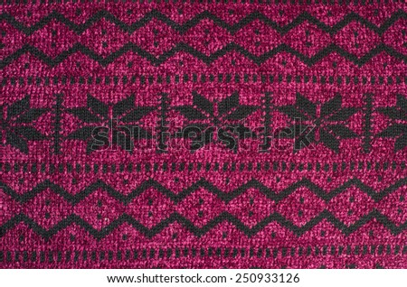 Close up on knit woolen texture. Winter snowflakes shapes pattern background. - stock photo