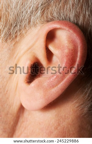 Close up on male ear. - stock photo