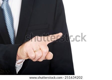 Close up on male finger pushing abstract button. - stock photo