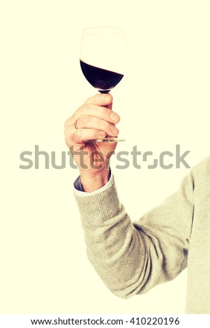 Close up on male hand holding a glass of wine - stock photo