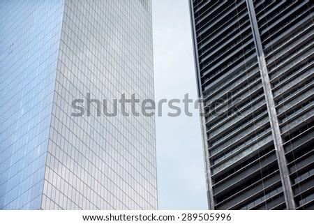 close up on new york manhattan iron and glass skyscraper - stock photo