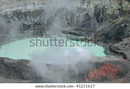 Close up on Poas Volcano Crater with misty sulfur clouds, in Costa Rica eco park - stock photo