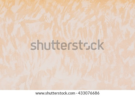 Close up on sandy colored wall and random pattern of white strokes with copy space for background - stock photo