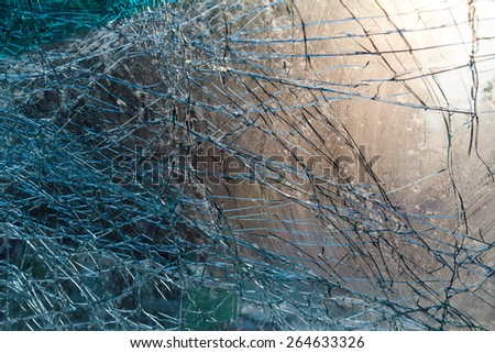Close up on the inside of the windshield cracks visible light due to an accident. - stock photo