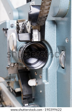 close up on the lens of a 16 mm film projector - stock photo
