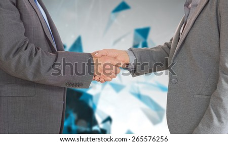 Close up on two businesspeople shaking hands against angular design - stock photo