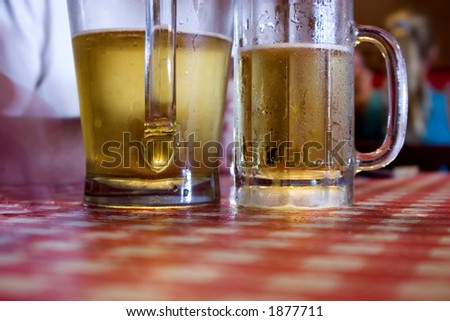 Close up on Two Glasses of Beer Sweating - stock photo
