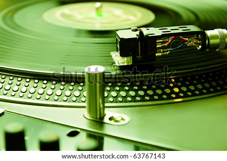 Close up on vinyl turntable record player. Technology for audio enthusiast, hi-fi music lover or professional disc jockey. DJ equipment for party, concert, scratching practice