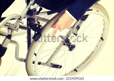 Close up on woman's hand on wheelchair. Isolated on white. - stock photo