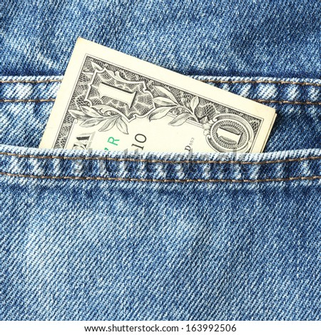 Close up one US dollar banknote in blue jeans pocket - stock photo
