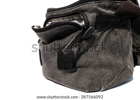 Close up opened camera bag, isolated on white background
