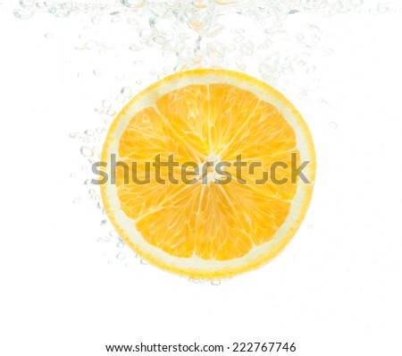 close-up orange slice in water with bubbles