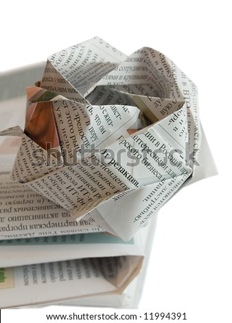 Close up origami newspaper rose isolated on white background