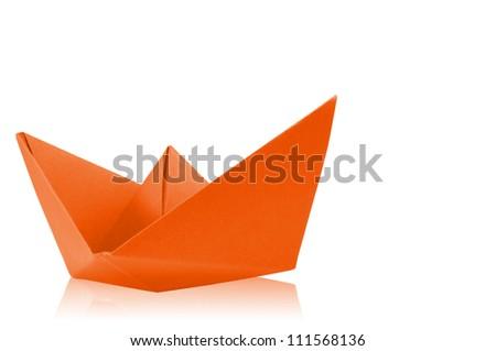Close up origami orange paper ship on white background. - stock photo