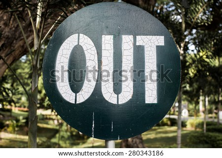 close-up Out sign with blur tree background - stock photo
