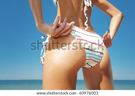 close up outdoor shot of young woman's back - stock photo