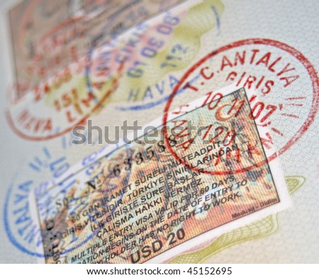 Close-up page of passport with turkish visas and stamps - stock photo